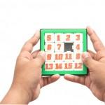 Hand holding Number Slider Puzzle